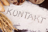 Kontakt, written in flour — Stockfoto