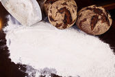 Baked bread and flour — Stock Photo