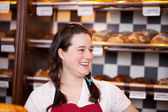 Female apprentice at the bakery — Stock Photo