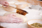 Glazing uncooked bread — Stock Photo
