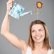 Smiling young woman making ideas grow — Stock Photo