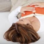 Woman fallen asleep while reading — Stock Photo