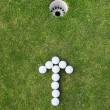 Golf balls arranged as arrow sign — Stock Photo #27160529