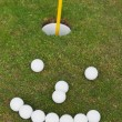 Smiley Face Made Of Golf Balls On Grassy Field — Stock Photo #27161387