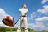Man Holding Golf Club Against Sky — Stock Photo