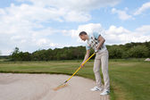 Golfer racking sand — Stock Photo