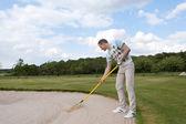Golfer racking sand — Stock Photo