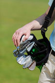 Man carrying golf bag — Stock Photo