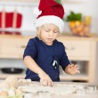Little girl baking Christmas cookies — Stok fotoğraf