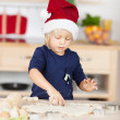 Little girl baking Christmas cookies — Stock Photo #27170293