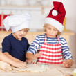 Little girls baking Christmas cookies — Stock Photo