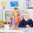 Siblings Drawing Together On Table — Stock Photo