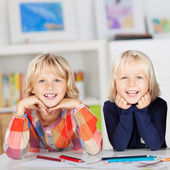 Siblings With Drawing Papers And Pencils Leaning On Table — Stock Photo