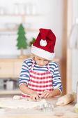 Cute girl baking Christmas cookies — Stock Photo