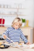Girl Baking Cupcakes At Kitchen Counter — Stock Photo