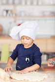 Girl Using Cutter On Dough — Stock Photo