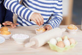 Girls Icing Cupcakes At Kitchen Counter — Stock Photo