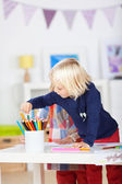 Girl Choosing Colored Pencil From Organizer On Table — Stock Photo