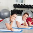 Group Lying On Mat At Gym — Stock Photo