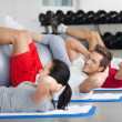 Group With Fitness Ball Practicing Crunches In Gym — Stock Photo