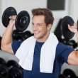 Man Lifting Dumbbells In Gym — Stock Photo #27196557