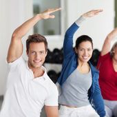 Group Doing Stretching Exercise In Gym — Stock Photo