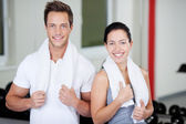 Couple With Towels Standing Together In Gym — Stock Photo