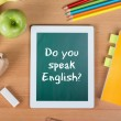 Stock Photo: Do you speak English question in school tablet