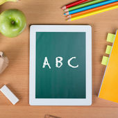Digital tablet on a school desk with ABC written — Stock Photo