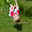 Small boy playing on his swing — Stock Photo