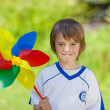 Boy Holding Pinwheel In Yard — Stock Photo