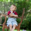 Sweet little boy on a wooden bench — Stock Photo #27210739
