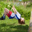 Little boy on swing — Stock Photo
