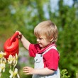 Little boy with his watering can — Stock Photo