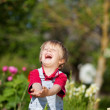 Boy With Hands Cupped Laughing In Yard — Stock Photo #27210857