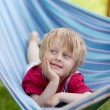 Relaxing in a hammock — Stock Photo #27210947