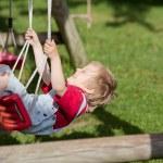 Boy Swinging In Playground — Stock Photo