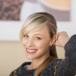 Seductive blond woman with a friendly smile — Stock Photo