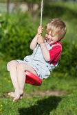 Cute Boy Swinging In Playground — Stock Photo
