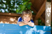 Boy Leaning On Treehouse's Wall At Playground — Stock Photo