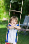 Boy Leaning On Rope Ladder In Playground — Stock Photo