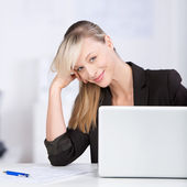 Blond woman with laptop — Stock Photo