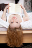Woman Holding Book While Lying In Bed — Stock Photo