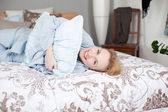 Woman Hugging Pillow While Lying In Bed — Foto de Stock
