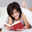 Woman Reading Book While Lying In Bed — Stock Photo