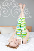 Woman Lying On Bed With Feet Up — Stock Photo