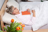 Senior woman fall asleep — Stock Photo