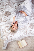 Senior Woman Using Cordless Phone While Lying In Bed — Stock Photo