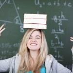 Student balancing three books — Stock Photo #27312659