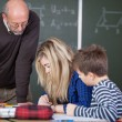 Teacher is checking on students — Stock Photo